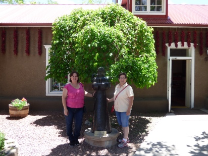 My sister and I outside Rancho de Chimayo.