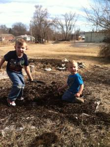 My grandsons helping me prep the garden.