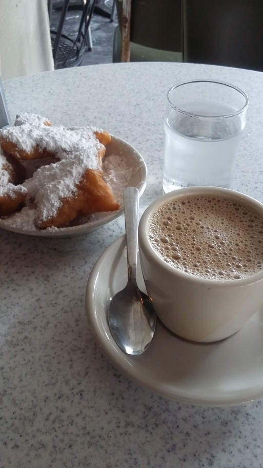 Cafe au lait and beignets at Cafe du Monde.